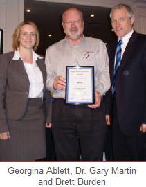 Image of ATTAR team & Brett Burden receiving and award